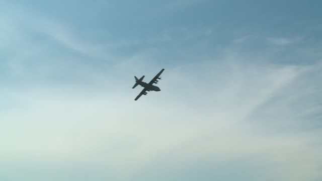 lockheed c-130 hercules, a four-engine turboprop military transport aircraft, flying overhead at the gary/chicago international airport before the... - chicago air and water show stock videos & royalty-free footage