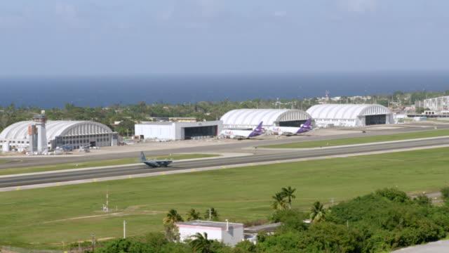 WS TS Lockheed C-130 Hercules landing on runway at Rafael Hernandez Airport / Aguadilla, Puerto Rico, United States