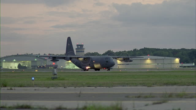 ms, lockheed c-130 hercules on runway at dusk, stewart international airport, new windsor, new york, usa - air force stock videos & royalty-free footage