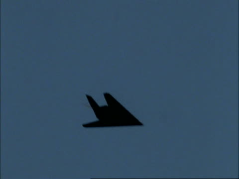 ms lockheed f117 stealth night hawk bomber flies in blue sky, england, uk - fighter stock videos and b-roll footage