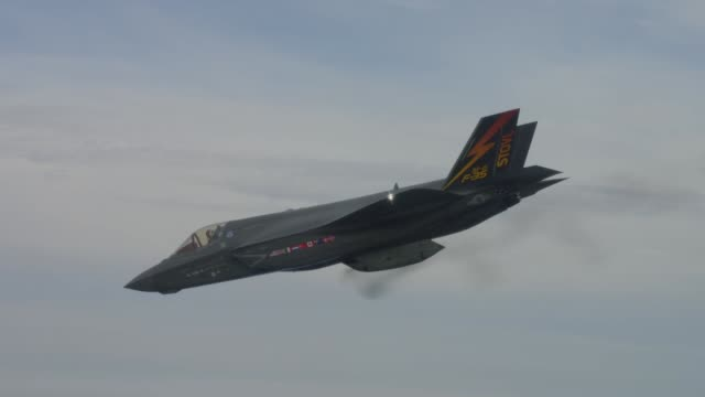 lockheed martin f35 lightning ii fighter jet firing its gau22 gun pod for the first time - stealth stock videos & royalty-free footage