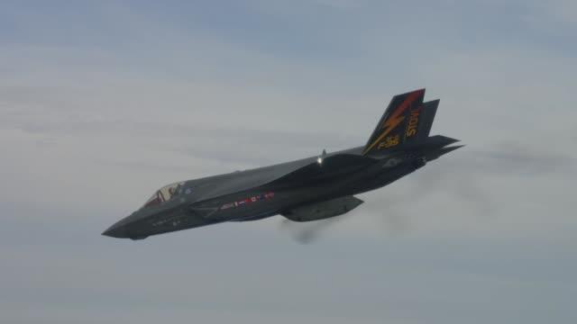 Lockheed Martin F35 Lightning II fighter jet firing its GAU22 gun pod for the first time
