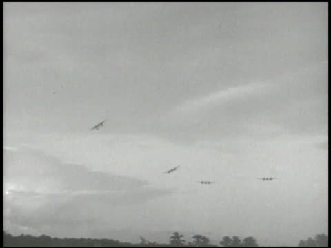 Lockheed P38 'Lightening' twinengine heavy fighters in flight PAN Bell P39 'Airacobra' single engine fighters in flight to WS Four P39s Campaign...