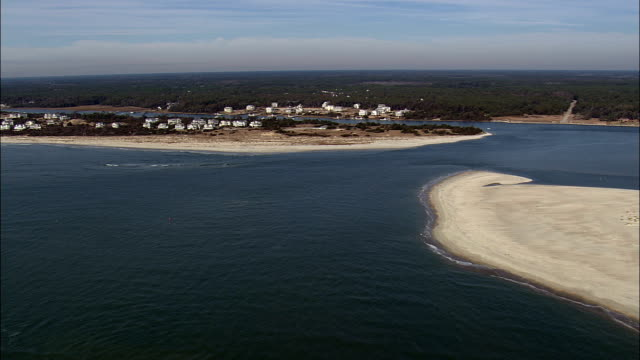 lockwood's folly inlet  - aerial view - north carolina,  brunswick county,  united states - inlet stock videos & royalty-free footage