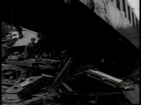 locomotive laying on side. vs wreckage of derailed train, people standing, looking, possibly french resistance, maquis, saboteurs, terrorists. wwii,... - sabotage stock videos & royalty-free footage
