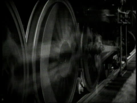 stockvideo's en b-roll-footage met 1940 cu locomotive wheels traveling along track / united states - locomotief