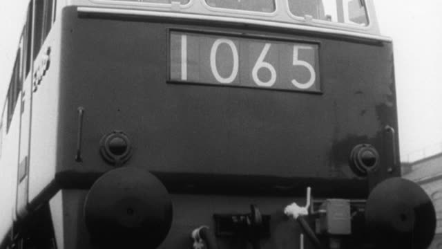 1965 montage locomotives and oil train riding on rails with dr. beeching narrating / united kingdom - narrating stock videos & royalty-free footage