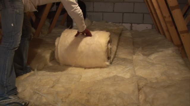 Loft / Attic Insulation being rolled out in roof space