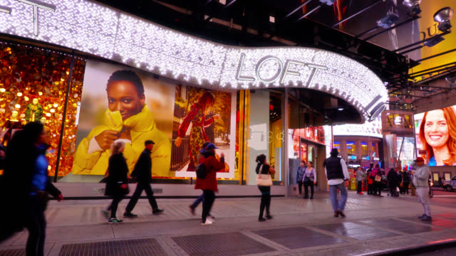 loft retail store at 42nd street and times square. people walk by. advertisements. - television show stock videos & royalty-free footage