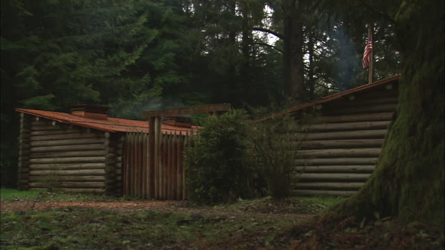 log cabins stand in the forest at fort clatsop national memorial in oregon. - westward expansion stock videos & royalty-free footage