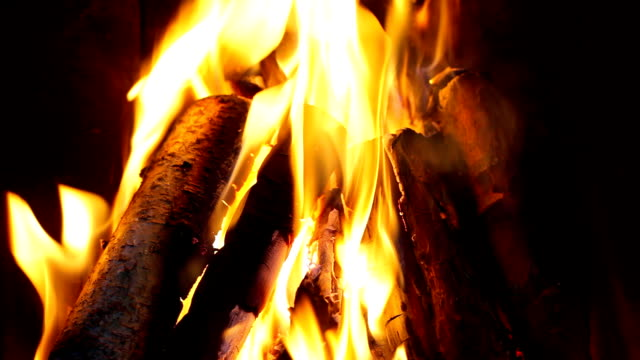 log fire in a fireplace - hd 1080p - fireplace stock videos and b-roll footage