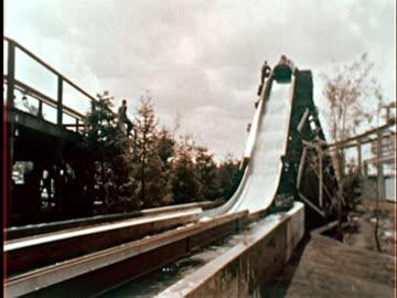 log flume water slide ride at new york world's fair/ from inside log speeding down slide/ queens, ny - new york world's fair stock videos & royalty-free footage