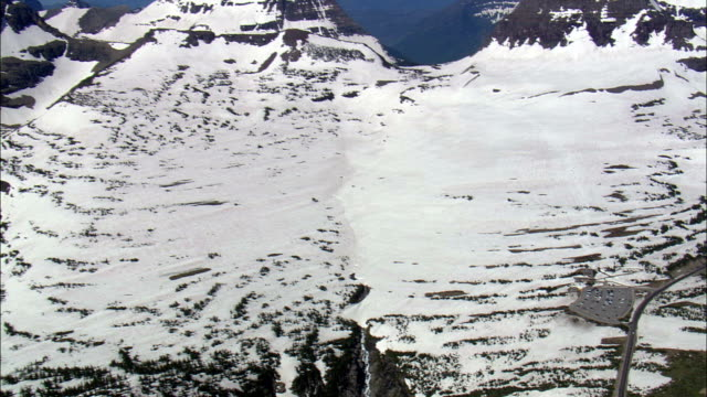 logan pass to siyeh bend  - aerial view - montana, glacier county, united states - mountain pass stock videos & royalty-free footage