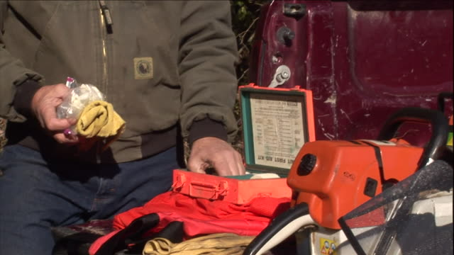 a logger examines the contents of a first aid kit. - first aid kit stock videos & royalty-free footage
