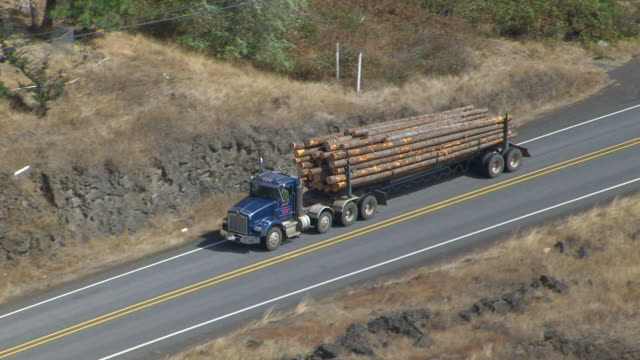 WS ZI TS AERIAL POV Logging truck moving on highway / Washington, United States
