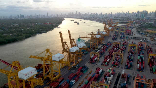 logistic business or transport concept : aerial top down view over import export port of thailand with many stacks of cargo container rows and big cranes. - port of los angeles stock videos & royalty-free footage