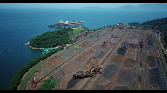 mrs logistica trains and ships carry iron ore to itaguai ports in sepetiba bay rio de janeiro brazil on monday march 19 2018 - iron ore stock videos & royalty-free footage