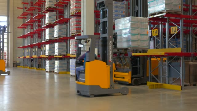 logistics centre of a mail-order company for office products, grossostheim, bavaria, germany, europe - forklift truck stock videos and b-roll footage
