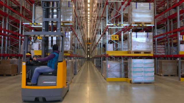 logistics centre of a mail-order company for office products, grossostheim, bavaria, germany, europe - packet stock videos and b-roll footage