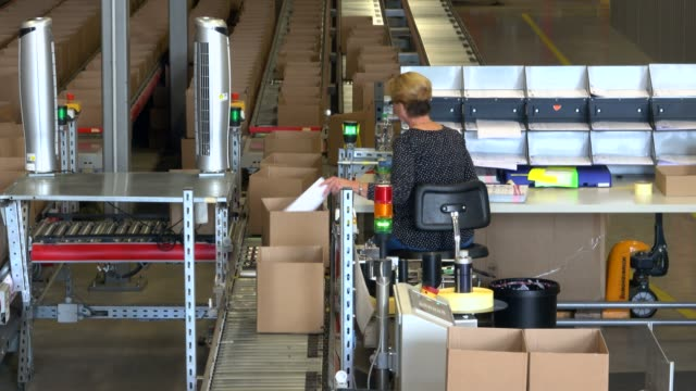 logistics centre of a mail-order company for office products, grossostheim, bavaria, germany, europe - packet stock videos & royalty-free footage