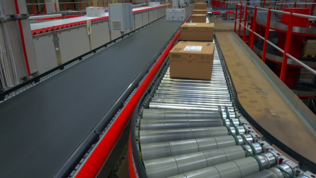 logistics centre of a mail-order company for office products, grossostheim, bavaria, germany, europe - 段ボール箱点の映像素材/bロール