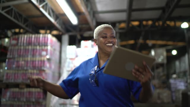 logistics employee dancing at warehouse - satisfaction stock videos & royalty-free footage