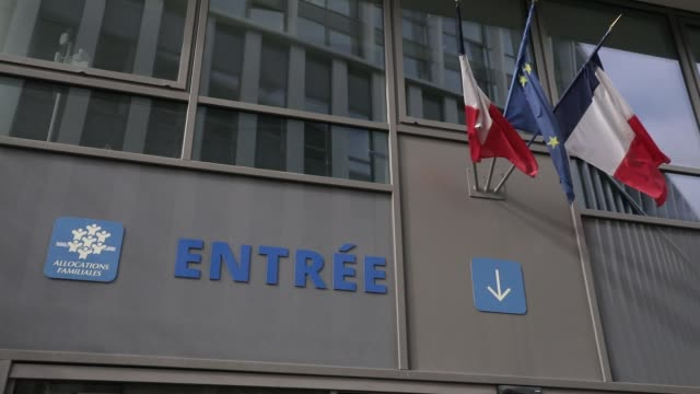 logo and french flags pictured at the entrance of a family allowance fund state office on september 30, 2020 in versailles, france. french minister... - beneficiary stock videos & royalty-free footage