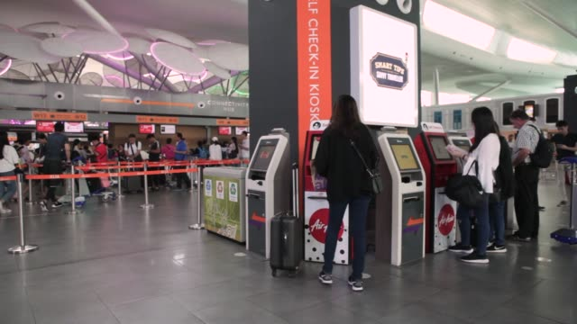 Logo for AirAsia Bhd is displayed on an automated checkin machine at Kuala Lumpur International Airport 2 in Sepang Selangor Malaysia on Thursday May...