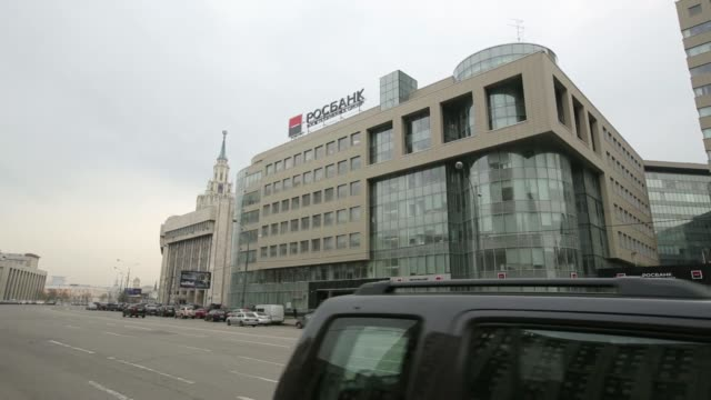a logo for the societe generale group sits on display outside the headquarters of oao rosbank in moscow russia on tuesday april 22 traffic passes the... - deutsche bank stock videos & royalty-free footage