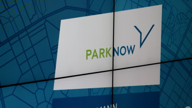Logo of the brand PARK NOW on a display in the conference room Dieter Zetsche CEO of Daimler AG and Harald Krüger CEO of BMW AG spoke to the media...
