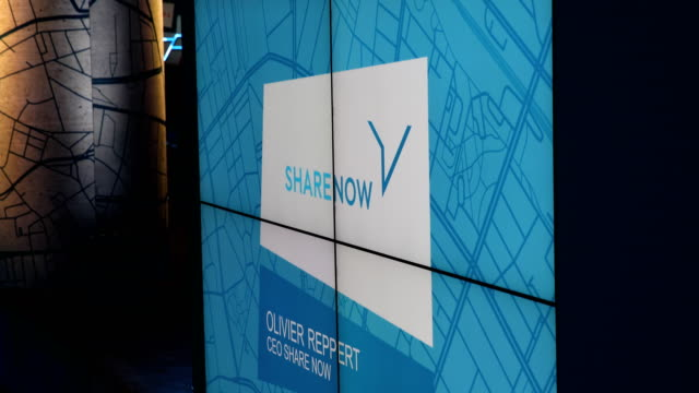 Logo of the brand SHARE NOW on a display in the conference room Dieter Zetsche CEO of Daimler AG and Harald Krüger CEO of BMW AG spoke to the media...