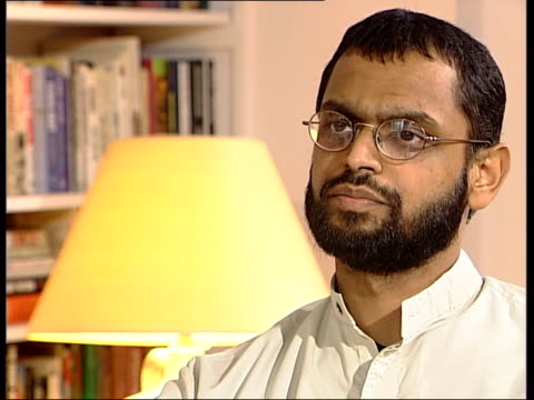 logo on screen moazzam begg interview sot i visited a camp at that time/ this was a camp run by kurds who had been fighting against saddam hussein's... - moazzam begg stock videos & royalty-free footage