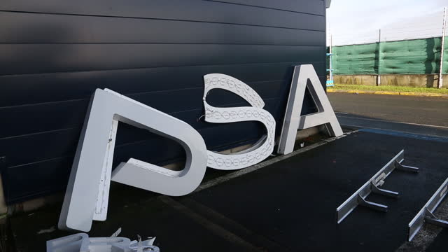 logo removed before replacing it with stellantis' in psa's automotive design network site in velizy , île-de-france, france, in monday, january 18,... - capital letter stock videos & royalty-free footage
