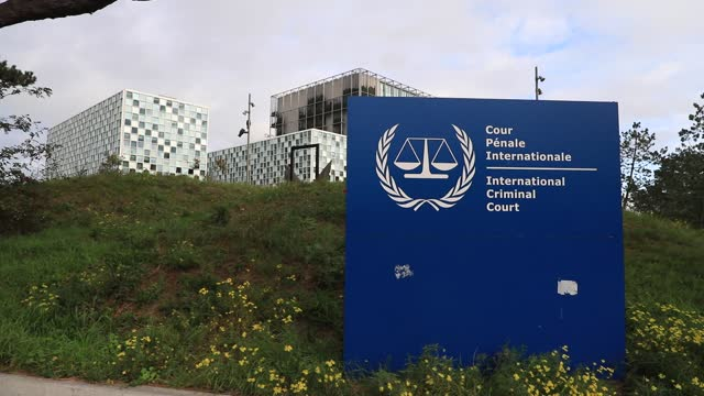 logo sits in front of the international criminal court building on october 18 in the hague, the netherlands. targeted by us sanctions since... - partisan politics stock videos & royalty-free footage