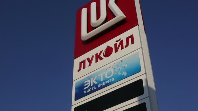 logo sits on a sign outside a gas station operated by tnk bp ltd in kiev, ukraine, on saturday, march 22 various general views a logo sits a sign... - ukraine stock videos & royalty-free footage