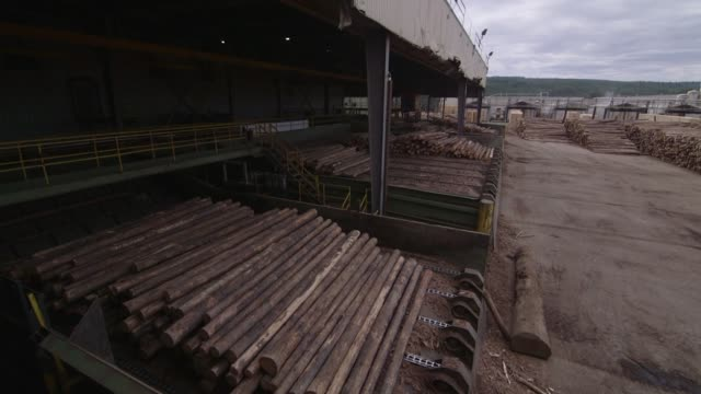 Logs are loaded onto a machine for bark removal at the West Fraser Timber Co sawmill in Quesnel British Columbia Canada on June 5 2015 Shots Wide...