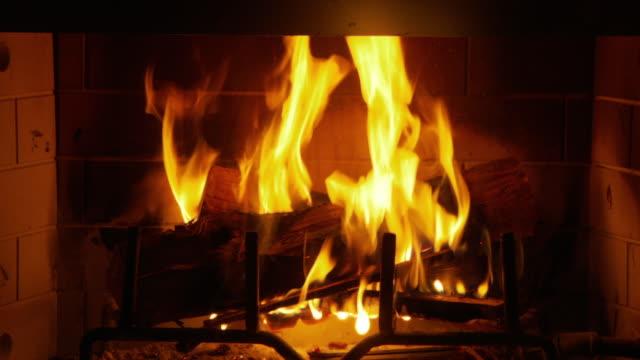 cu, logs burning in fireplace, atlanta, georgia, usa - warming up stock videos & royalty-free footage