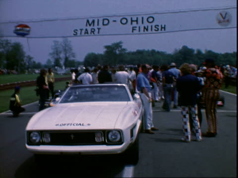 lola t330 chevrolet v8 other f5000 race cars parked in pits prerace midohio sports car course / race car driver mark donohue looking pensive almost... - mustang convertible stock videos & royalty-free footage