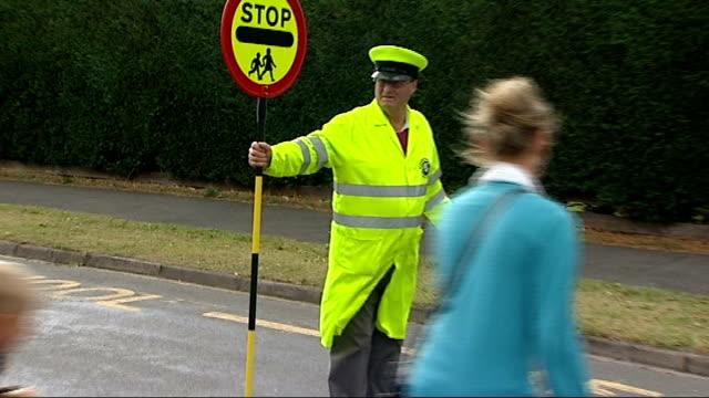 lollipop man standing in road as children cross - lollipop stock videos & royalty-free footage
