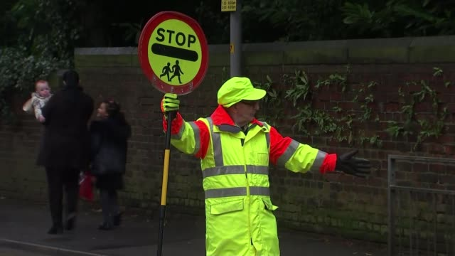 Lollipop man told giving children high fives as they cross the road is 'disruptive' ENGLAND Greater Manchester Stockport EXT Colin Spencer along from...