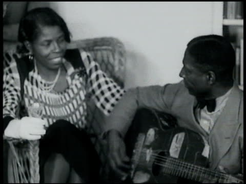 Lomax home in Connecticut Leadbelly in home playing humming to fiance Martha Promise