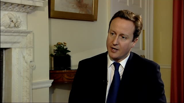 downign street: int david cameron mp interview sot - we will judge him by his actions not his words/ un security council resolution is clear and says... - last stock videos & royalty-free footage