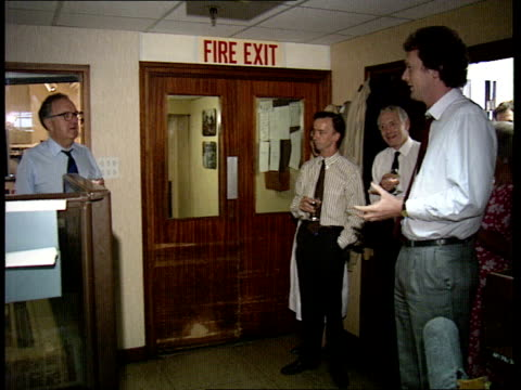 20 itn chairman david nicholas walks into newsroom and itn is greeted by editor stewart purvis wife juliet nicholas and others newsreader alastair... - wife carrying stock videos and b-roll footage