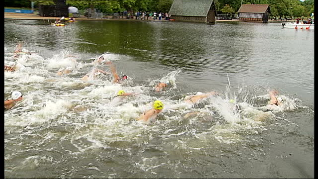 london 2012 olympic games: 10km marathon swimming test event; england: london: hyde park: serpentine: ext female swimmers diving into serpentine at... - kilometre stock videos & royalty-free footage