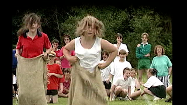 2012 school games held at olympic stadium file / d0617998 orig t21079303 england dorset christchurch schoolchildren competing in sack race... - sack race stock videos & royalty-free footage