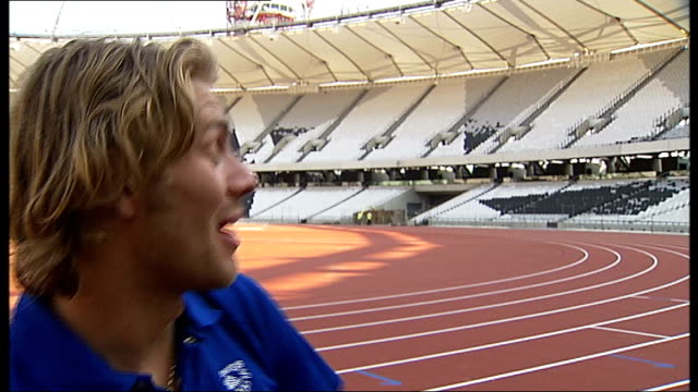 athletics track at olympic stadium completed hannah england interview sot chris tomlinson interview sot dan greaves interview sot lord coe and hannah... - greave stock videos and b-roll footage