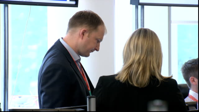 boris johnson visits transport coordination centre 'network rail' sign / 'surface transport traffic operations' sign / woman consulting tube map /... - co ordination stock videos & royalty-free footage