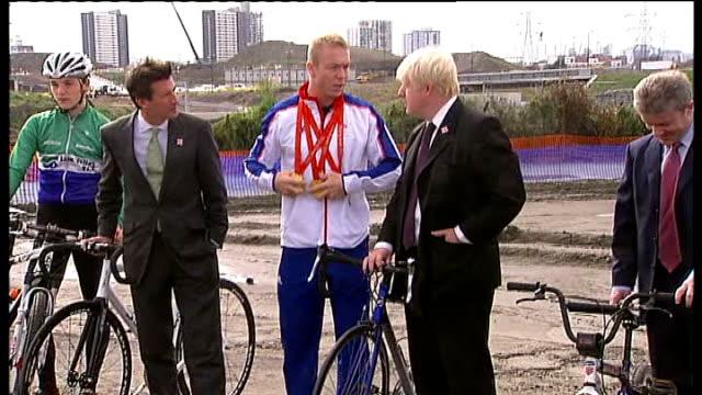 london 2012 olympic games: chris hoy unveils velodrome plans / photocall / boris johnson interview; england: london: stratford: ext sebastian coe ,... - hoy stock videos & royalty-free footage