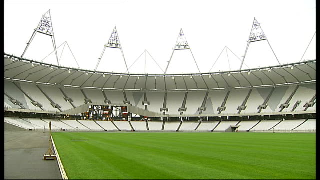 london 2012 olympic games: colonel gaddafi not attending event; r29031120 various views of completed olympic stadium showing turf laid and seats... - turf stock videos & royalty-free footage
