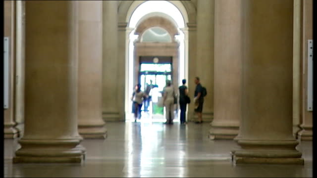 Commissioned artworks T30060835 ENGLAND London Tate Britain INT Various of sprinters running through Tate Britain gallery as part of art installation...